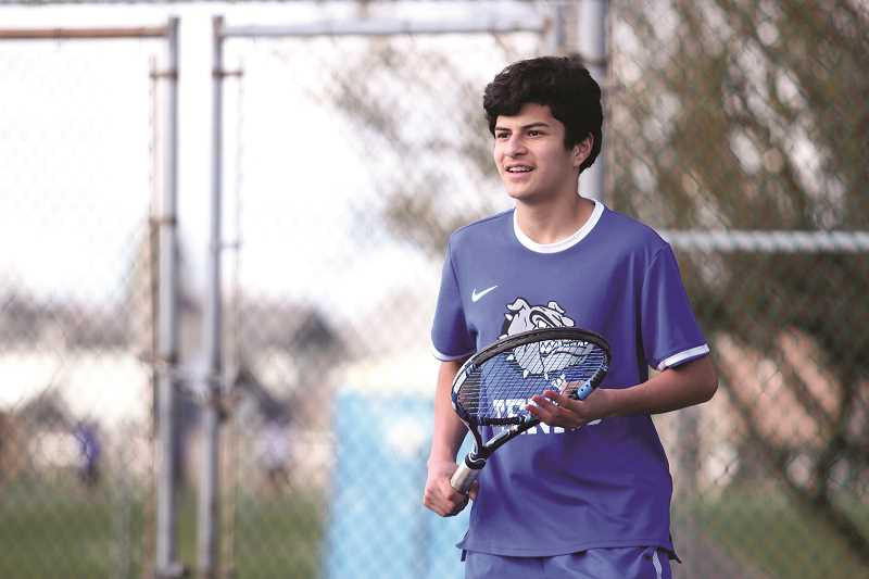 PHIL HAWKINS - Woodburn freshman Jonathan Swenson opened the spring season in the No. 1 singles position for the Bulldog boys tennis program. Swenson is one of 11 freshmen or sophomores in the starting lineup for the team's first match of the season against Dallas on Friday.