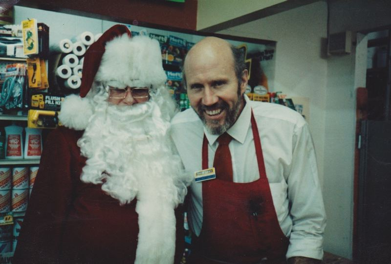 COURTESY PHOTO - Cliff Davis, Hoodland Thriftway Manager in the 1980s, poses with Santa Claus. In 1984 during an armed robbery at the store, Cliff and two employees were temporarily held hostage. The remarkable and bizarre details of the robbers modus operandi catapulted this uncommon heist into the national and even international news headlines.