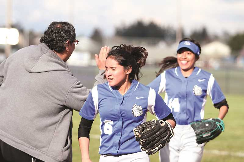 PHIL HAWKINS - The Woodburn softball team opened the 2018 season with a 16-4 loss at Molalla and an 11-4 loss in their home opener against McKay on Friday.