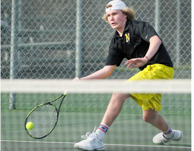 SETH GORDON - Quinton Nybur stretches for a forehand shot during Newberg's 6-1 home win over Forest Grove March 15. Nybur lost his No. 1 singles match 7-6 (7-4), 6-7 (7-4), 3-6.