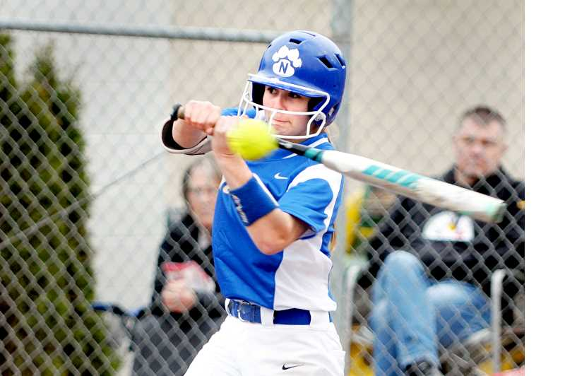SETH GORDON - Katelynn Evans takes a cut during Newberg's 3-1 home loss to South Eugene in the season opener March 15.
