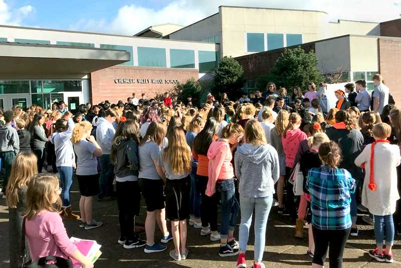 SUBMITTED PHOTO - A large group of Chehalem Valley Middle School students participated in an nationwide walkout March 14 in response to the shootings at Marjory Stoneman Douglas High School in Florida. After a short speech and a moment of silence, the students circled the track behind the school for 17 minutes in honor of the 17 student who died in the recent attack.