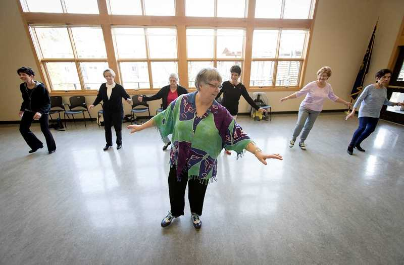 SPOKESMAN PHOTO: JAIME VALDEZ - Tibbles (center) has taught tap dancing for more than 35 years, and about 12 of those shes spent teaching her weekly class at the Wilsonville Community Center.