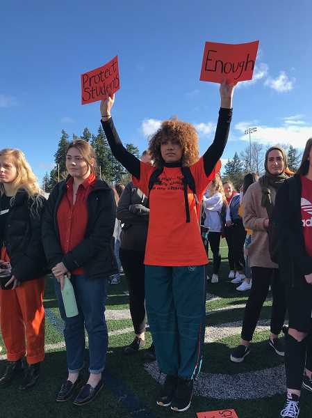 SUBMITTED PHOTO: SIERRA BISHOP - Senior Imani Wolery holds up signs during the national walkout WHS participated in.