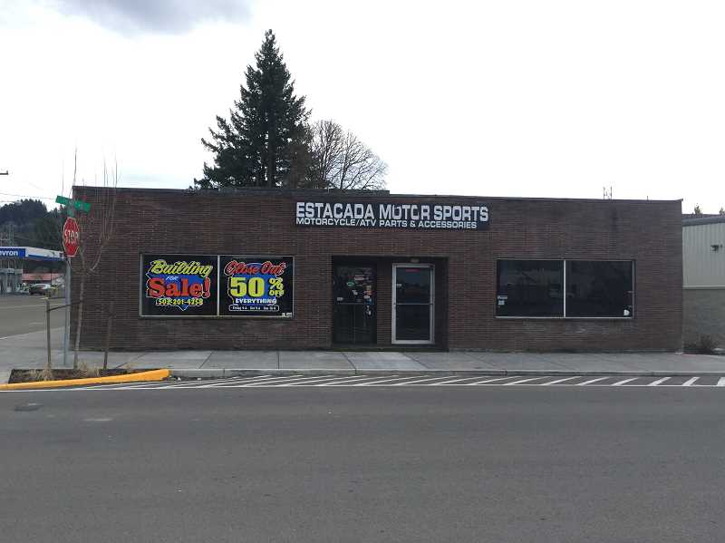 FILE PHOTO - If all goes according to plan, the former Motor Sports building will eventually be occupied by Clackamas River Outfitters and Yo Treats frozen yogurt. City staff are seeking additional bids for the project after the initial few came in over budget.
