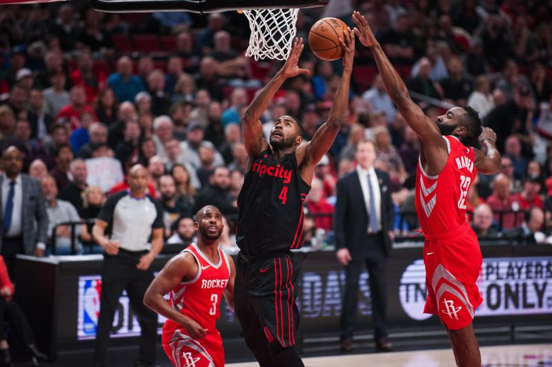 TRIBUNE PHOTO: JOHN LARIVIERE - Moe Harkless of the Trail Blazers battles around the basket against the Houston Rockets' Chris Paul (left) and James Harden.