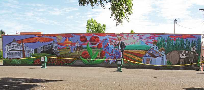 INDEPENDENT FILE PHOTO - Public art projects, like this mural on the south wall of the Woodburn Independent building, are approved by a committee, which is currently seeking new members.