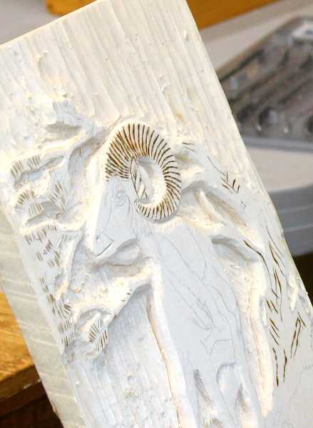 Group leader Dave Rood worked on a carving of a big horn sheep.