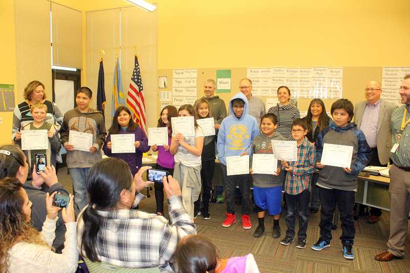 SUSAN MATHENY/MADRAS PIONEER - Warm Springs K-8 students who exceeded state standards on the Smarter Balance state assessment tests received certificates from school administrators at the March 14 meeting of the 509-J School District Board of Directors. From left to right, students include: Trevor Montgomery, Nathaniel LeClaire, Esther Kalama Tufti, Sophia Medina, Serenity Bisland, Kalyn Leonard, Gunner Bailey Jr., Latrell VanPelt Graybael, Wallace Herkshan and RicoDave Perez Greene.