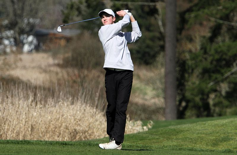 PAMPLIN MEDIA GROUP: MILES VANCE - Senior Nathon Mallory helped the Tigard boys golf team take first place at Mondays Three Rivers League tournament.