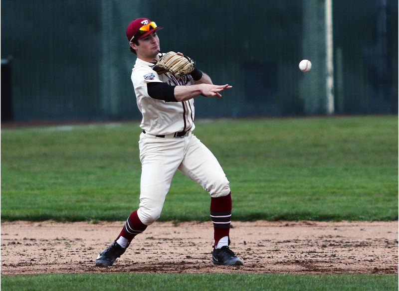 TIMES PHOTO: DAN BROOD - Tualatin junior shortstop Kyle Dernedde makes a throw to second base during the Wolves' game with Beaverton.