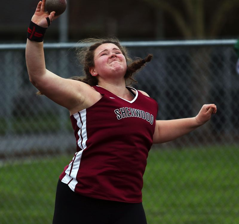TIMES PHOTO: DAN BROOD - Senior Clair Johnson took sixth place in the shot put event at last years Class 6A state track and field championships.