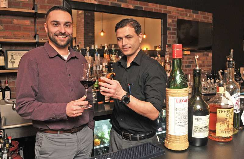 Nicoletta's Table General  Manager Ameer  Ghassemi, left, and Bar Manager Nick West welcome patrons to drop in till 11 p.m. on Friday and Saturday nights and enjoy nightlife in Lake Oswego.