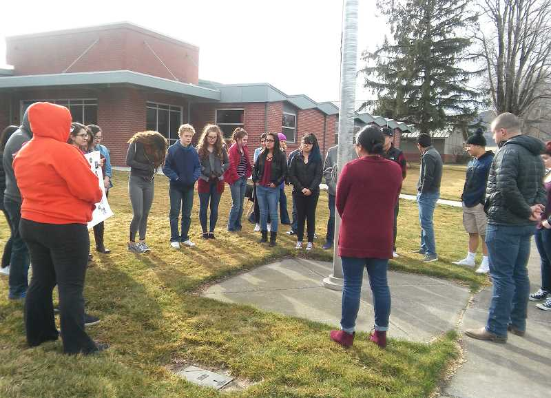 DEBBIE LYONS - Culver High School students gathered around a flagpole for 17 minutes on March 14.