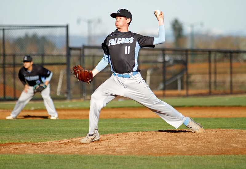 STAFF PHOTO: WADE EVANSON - Liberty's Ben Ineson throws a pitch during the Falcons' game against Forest Grove March 20 at Forest Grove High School.