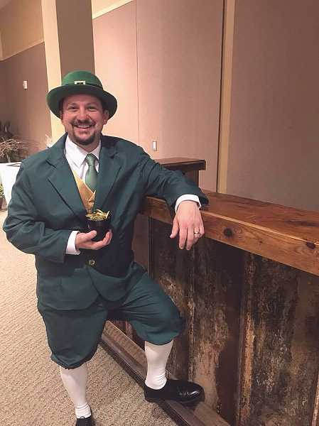 COURTESY PHOTO - Tom McConkey, dressed for the St. Patrick's Day theme, served as emcee at the auction.