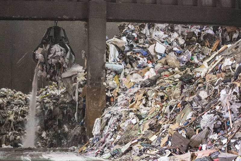 COURTESY PHOTO - Trash piles up at the Marion County Energy-From-Waste Facility in Brooks, which processes 550 tons per day of municipal solid waste.