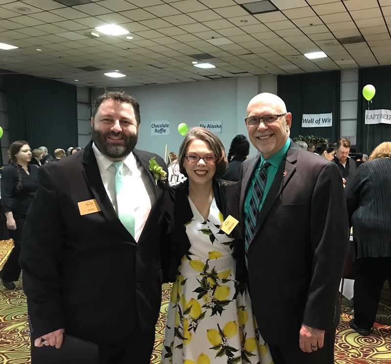 CONTRIBUTED PHOTO: SNOWCAP COMMUNITY CHARITIES - Nate Larsen, SnowCap Executive Director Kristen Wageman, and Pastor Don Frueh enjoyed celebrating at the annual charity dinner and auction.