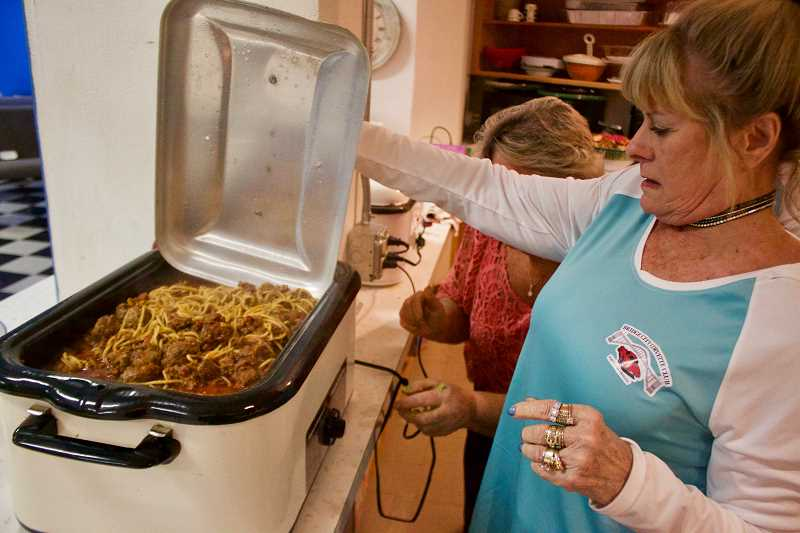 OUTLOOK PHOTO: CHRISTOPHER KEIZUR - Teri Helser shows off the spaghetti dinner being served Monday night, March 19.