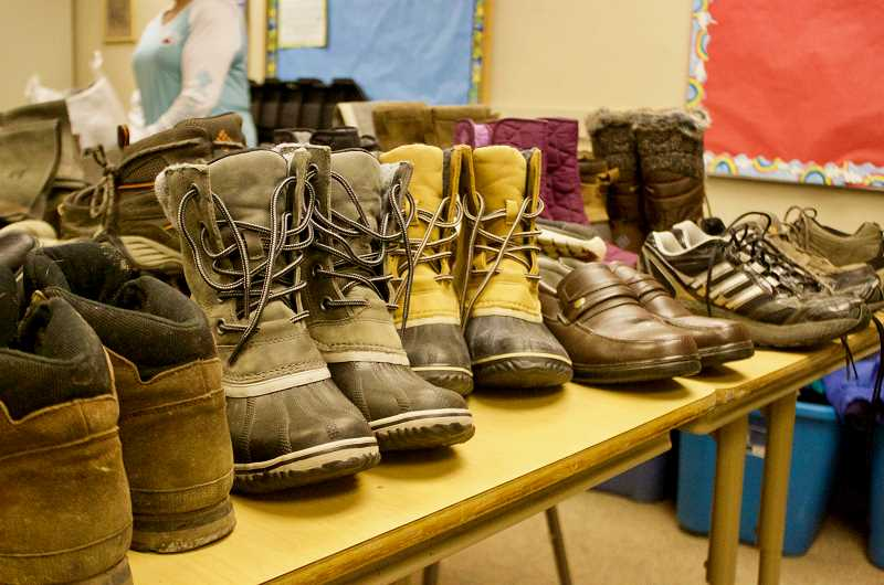 OUTLOOK PHOTO: CHRISTOPHER KEIZUR - At the First Baptist Church of Gresham, there are donated boots and clothes available to the homeless.