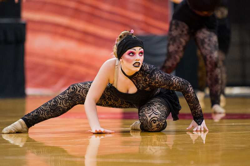 PMG PHOTO: JAIME VALDEZ - A Scappoose High School Vision Dance member performs the team's routine, 'Anybody Out There?,' during the OSAA dance and drill championships held at Veterans Memorial Coliseum in Portland March 15-17.