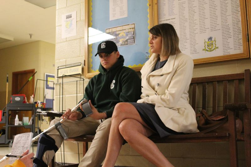 CONTRIBUTED PHOTO: LAUREN TIMZEN - Bobby and his mom Healther Asa chat with a reporter in the hall at Barlow.