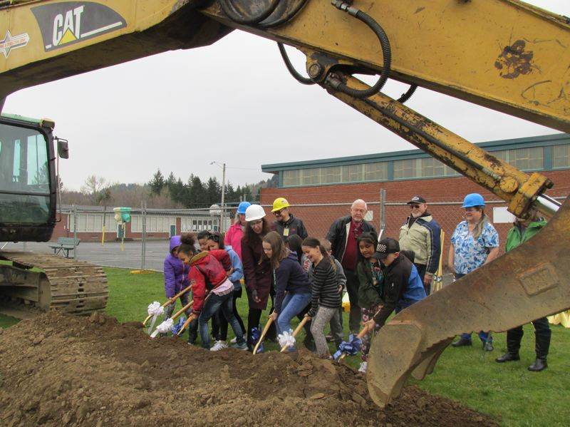 OUTLOOK PHOTO: TERESA CARSON - East Gresham Elementary School students led the groundbreaking ceremony on Wednesday, March 21, as some grown-ups looked on.