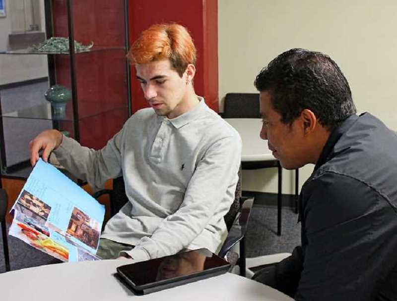 REVIEW FILE PHOTO: VERN UYETAKE - David Salerno Owens works with student Nathan Raclot last year as part of the Response to Intervention program at Lakeridge High School. Salerno was named equity director of the Lake Oswego School District on Friday.