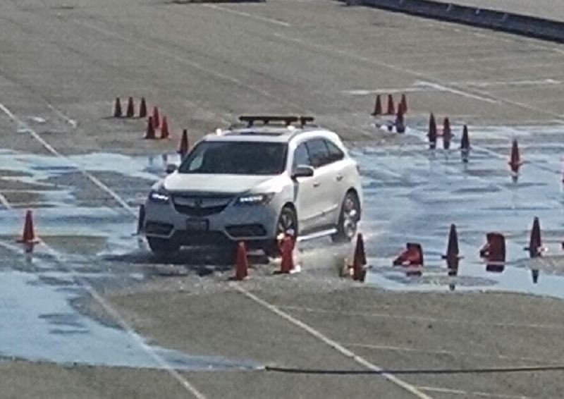 COURTESY JEFF PETERSON - Teen drivers learned how to handle slippery conditions during a safety class at Portland International Raceway.