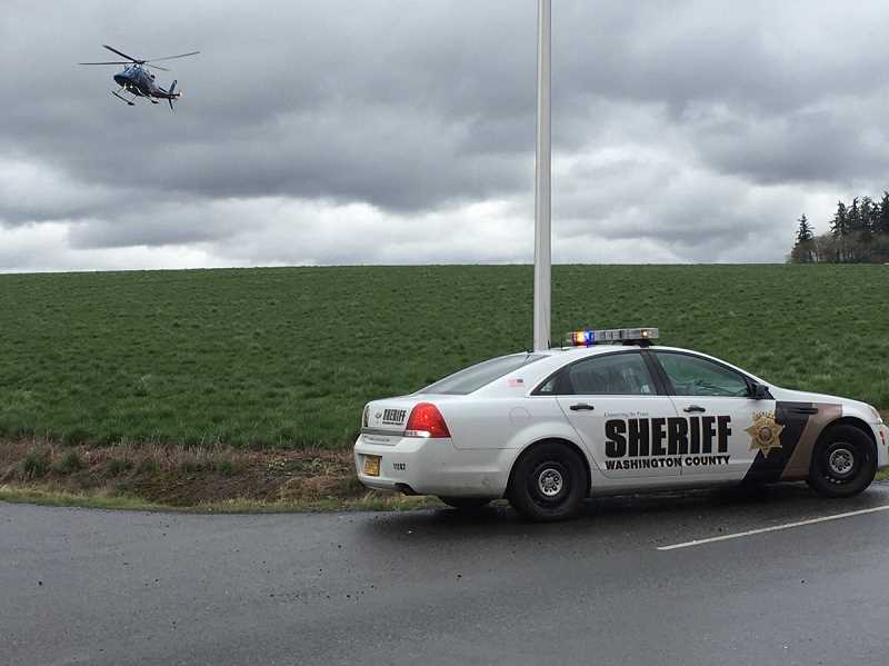 COURTESY PHOTO - A Life Flight helicopter prepares to land along Helvetia Road in Hillsboro, March 23.