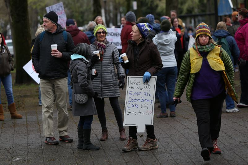TRIBUNE PHOTO: JESSIE DARLAND - Protesters gather ahead of the 'March for Our Lives' at the North Park Blocks in downtown Portland on Saturday, March 24.