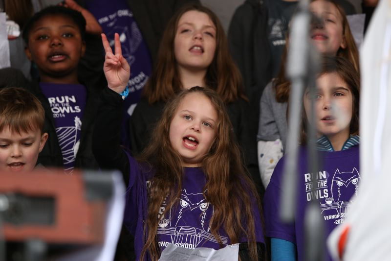 TRIBUNE PHOTO: JESSIE DARLAND - Members of the Vern Elementary School choir sing a rendition of the Bob Dylan classic 'The Times They Are A-Changin'' during the 'March for Our Lives' protest on Saturday, March 24 in Portland.
