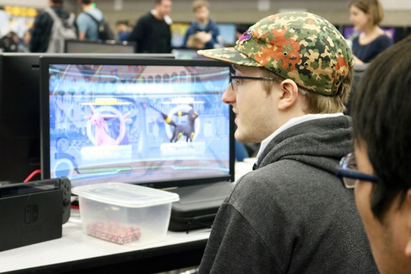 TRIBUNE PHOTO: ZANE SPARLING - Tony DeWitt, 20, plays a Pokemon videogame under the username NinjaFalcon 2 during a Pokemon tournament at the Oregon Convention Center on Sunday, March 25.