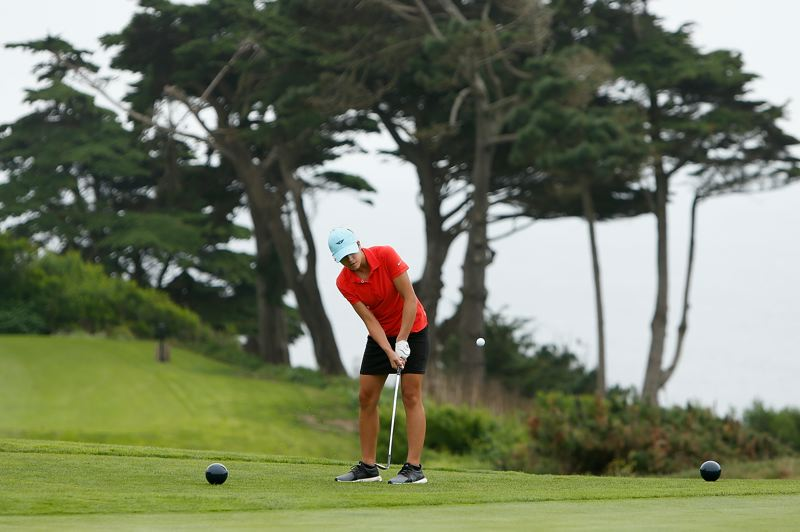 LACHLAN CUNNINGHAM/GETTY IMAGES - Elise Deschaine chips during the Drive, Chip & Putt regional qualifier at The Olympic Club in San Francisco. The Central Catholic High freshman placed first in the event to earn a spot in the national finals, Sunday at Augusta National.