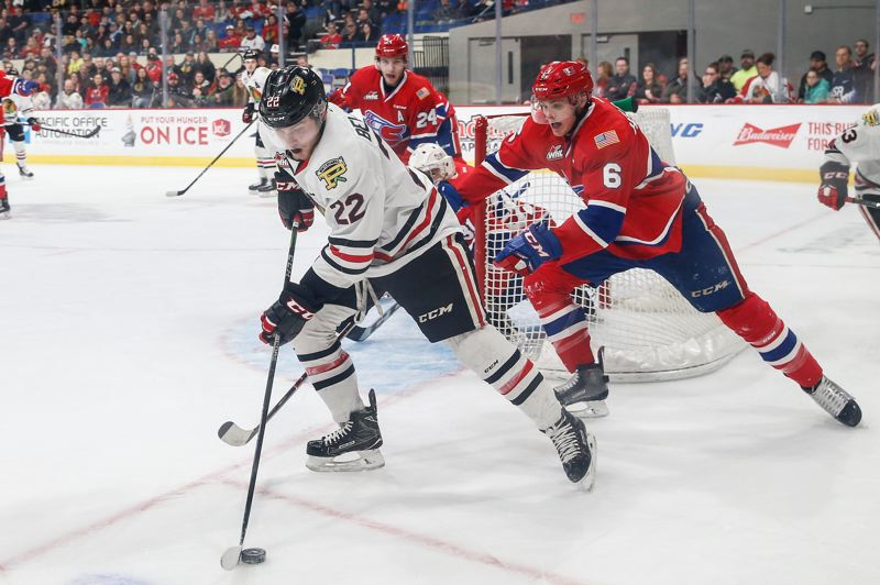 COURTESY: PORTLAND WINTERHAWKS/BEN LUDEMAN - Kieffer Bellows of the Portland Winterhawks holds on to the puck during Sunday's WHL playoff game against the Spokane Chiefs.