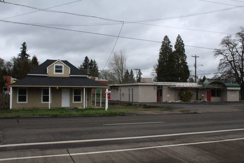 STAFF PHOTO: MARK MILLER - A house (left) and old industrial office property (right) were both purchased by the City of Forest Grove this month.