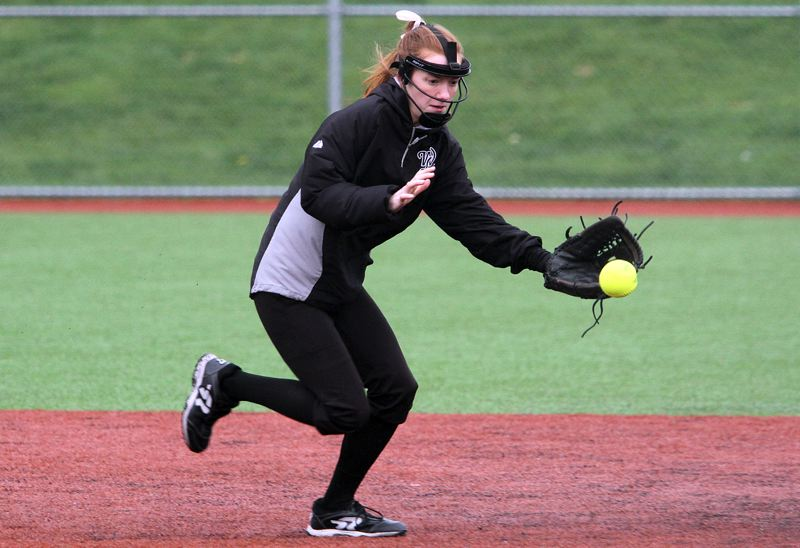 TIDINGS PHOTO: MILES VANCE - West Linn shortstop Taylor Maxwell gets ready to make a play during her team's 16-7 non-league win over St. Helens at Rosemont Ridge Middle School on Monday.