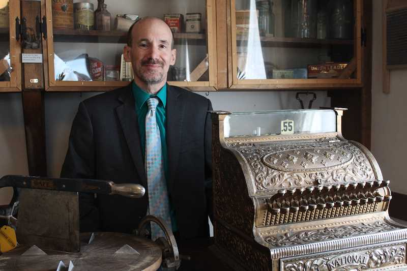 JASON CHANEY - Sandy Cohen was recently hired to fill the vacated Bowman Museum director position. He is hoping to make history as exciting for local residents as his grandfather made it for him years ago. In the above photo, Cohen stands in the museum's Paulina Room.