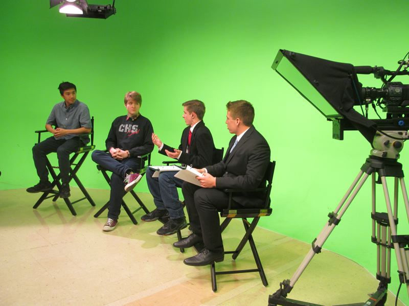 PHOTO BY ELLEN SPITALERI - From left, Clackamas High School seniors Artthew Ng and Bobby Campbell were interviewed during the recent student-led town hall by CHS juniors Zach Murray and Jake Bushman.