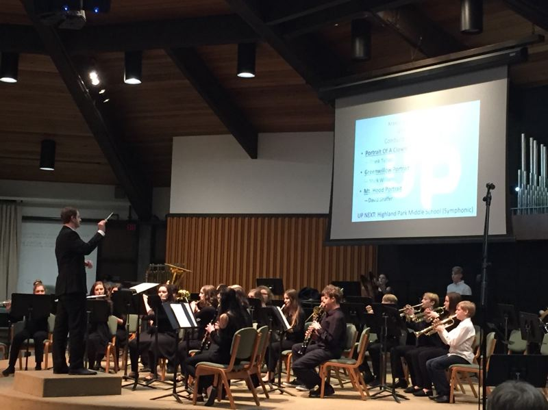 PHOTO COURTESY: LESLIE ROBINETTE - Director Seth Arnold conducts the Kraxberger Middle School Band in their performance at the Warner Pacific Band Festival.