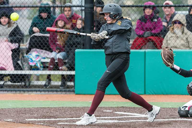 STAFF PHOTO: CHRISTOPHER OERTELL - Forest Grove's Kinsey Barnett takes a cut during the Vikings' win over Central Catholic March 26 at Hood View Park in North Clackamas.