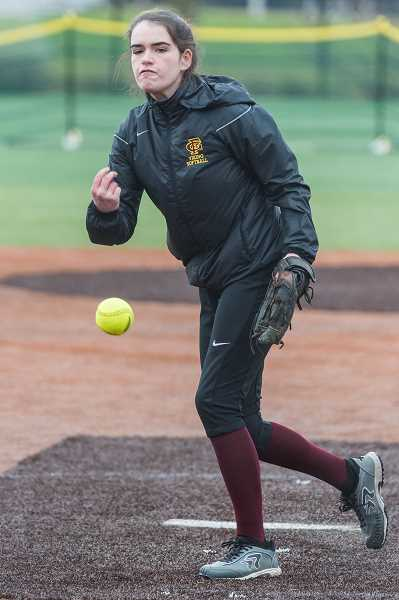 STAFF PHOTO: CHRISTOPHER OERTELL - Forest Grove's Delaney Aleshire hurls a pitch during the Vikings' win over Central Catholic March 26 at Hood View Park in North Clackamas.
