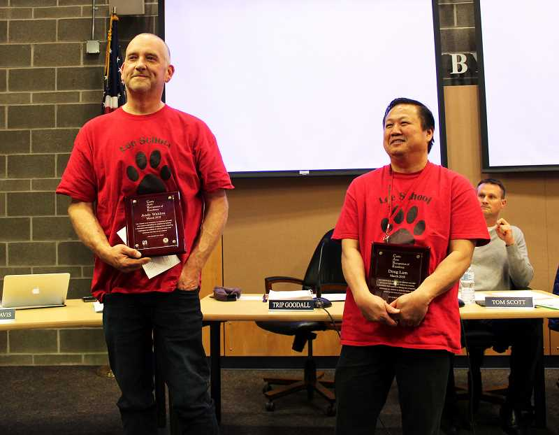 Lee Elementary School custodians Andy Waldron (left) and Dong Lam (right) were recently honored with the Canby School District CARE award.
