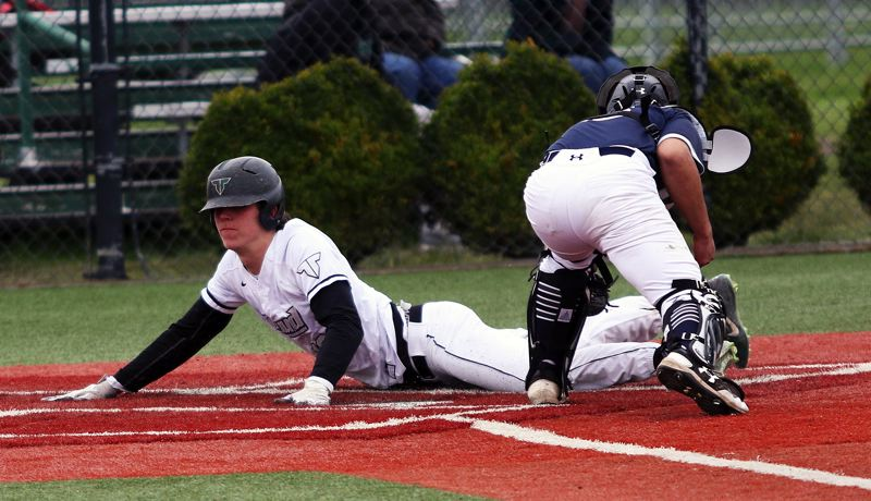 DAN BROOD - Tigard senior Nick Heinke slides to home plate, scoring on a sacrifice fly by C.J. Rivers, for the Tigers' first run in their 5-0 win over Wilsonville.