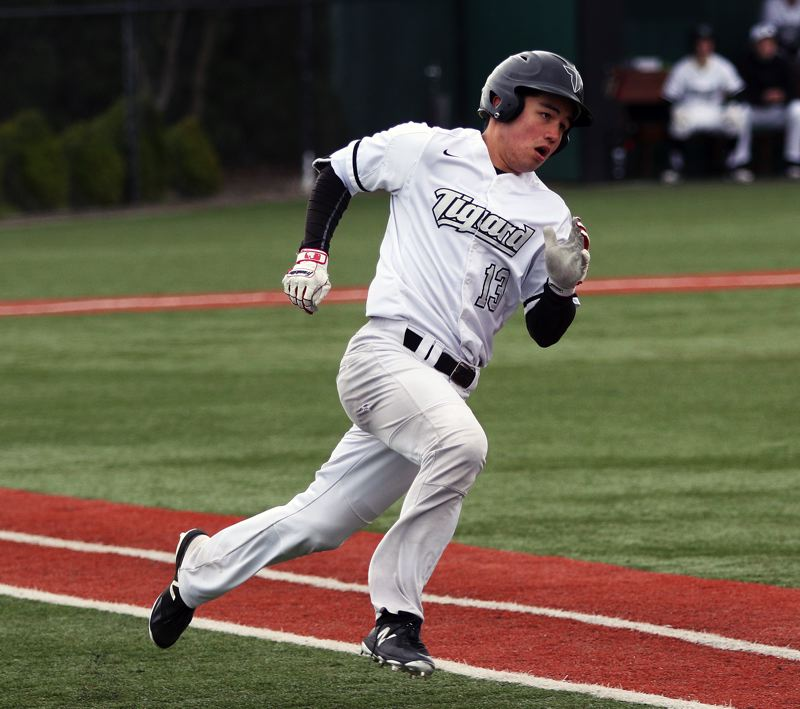 DAN BROOD - Tigard senior Micah O'Donnell rounds first base during the 5-0 win over Wilsonville.