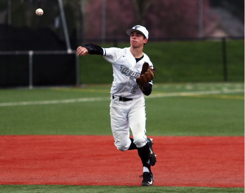 DAN BROOD - Tigard senior shortstop Michael Quintana makes a throw to first base during the Tigers' 5-0 win over Wilsonville.