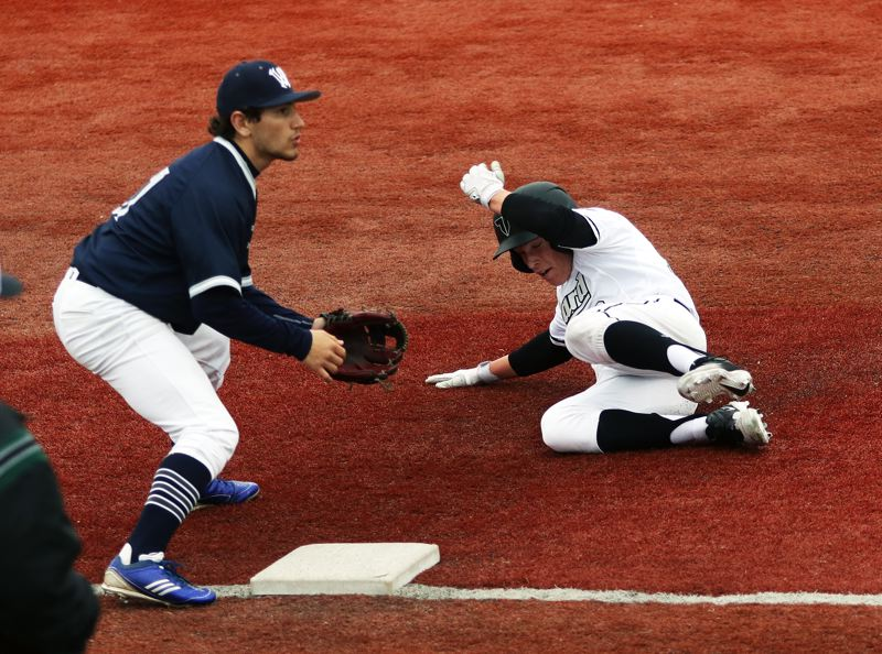 DAN BROOD - Tigard sophomore Tyler Penn (right) slides to third on a stolen base during the Tigers' 5-0 win over Wilsonville.