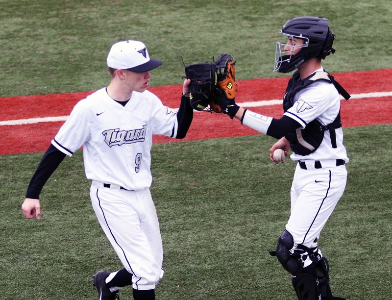 DAN BROOD - Tigard senior catcher Joey Cavalli (right) congratulates sophomore pitcher Sam Gerkman following the 5-0 win over Wilsonville on Monday.