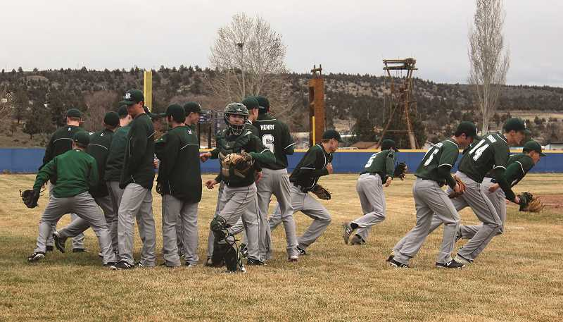 SUBMITTED PHOTO - The North Marion baseball team takes to the field.