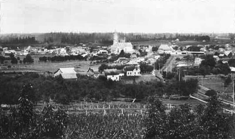 COURTESY PHOTO: MOUNT ANGEL HISTORICAL SOCIETY - This 1912 photo of Mount Angel above shows the newly built St. Mary's Catholic Church and the Catholic School, built in 1901, to the right of the church. The road along the right leads to Mount Angel Abbey.
